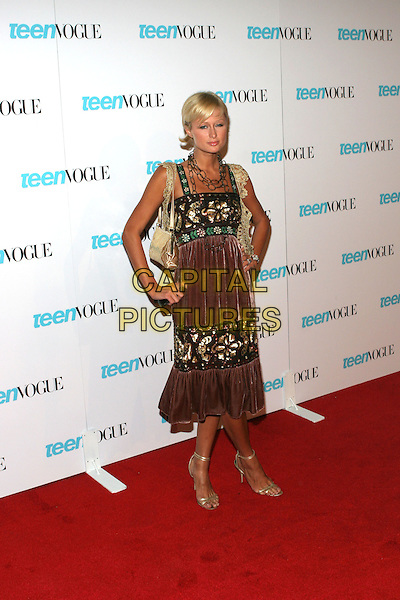 "PARIS HILTON.Teen Vogue Celebrates ""Young Hollywood Issue"" held at the Hollywood Roosevelt Hotel,.Los Angeles, 20thn September 2005.full length brown velvet dress red green sequin gol crochet knitted bolero hand hip.Ref"" ADM/ZL.www.capitalpictures.com.sales@capitalpictures.com.© Capital Pictures."