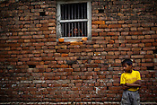 A woman looks out of her window in Village Sanau Sultan in Seohar district of Bihar, India. Photograph: Sanjit Das/Panos