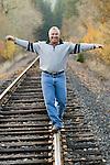 Man balancing railroad track