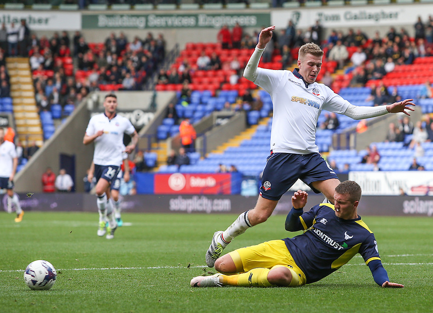 Oxford United's Joe Skarz wins an important tackle as Bolton Wanderers' Josh Vela makes progress in the box<br /> <br /> Photographer Alex Dodd/CameraSport<br /> <br /> The EFL Sky Bet League One - Bolton Wanderers v Oxford United  - Saturday 1st October 2016 - Macron Stadium - Bolton<br /> <br /> World Copyright &copy; 2016 CameraSport. All rights reserved. 43 Linden Ave. Countesthorpe. Leicester. England. LE8 5PG - Tel: +44 (0) 116 277 4147 - admin@camerasport.com - www.camerasport.com