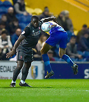 Lincoln City's John Akinde battles with  Mansfield Town's Ryan Sweeney<br /> <br /> Photographer Andrew Vaughan/CameraSport<br /> <br /> The EFL Sky Bet League Two - Mansfield Town v Lincoln City - Monday 18th March 2019 - Field Mill - Mansfield<br /> <br /> World Copyright © 2019 CameraSport. All rights reserved. 43 Linden Ave. Countesthorpe. Leicester. England. LE8 5PG - Tel: +44 (0) 116 277 4147 - admin@camerasport.com - www.camerasport.com