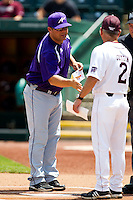 Head Coach Wes Carroll of the Evansville Purple Aces shakes hands with Head Coach Keith Guttin (2) of the Missouri State Bears prior to a game at Hammons Field on May 12, 2012 in Springfield, Missouri. (David Welker/Four Seam Images)