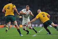 Chris Robshaw of England is tackled by Stephen Moore of Australia as Kane Douglas of Australia supports during Match 26 of the Rugby World Cup 2015 between England and Australia - 03/10/2015 - Twickenham Stadium, London<br /> Mandatory Credit: Rob Munro/Stewart Communications