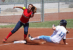Centennial's Lauren Stoman slides safely into third as Coronado's Alyssa Ayers waits for the ball during the state championship softball tournament at the University of Nevada, Reno, in Reno, Nev., on Saturday, May 20, 2012. .Photo by Cathleen Allison