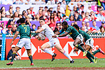 Mfundo Ndhlovu of South Africa (R) puts a tackle on Callum Sirker of England (C) during the HSBC Hong Kong Sevens 2018 match between South Africa and England on April 7, 2018 in Hong Kong, Hong Kong. Photo by Marcio Rodrigo Machado / Power Sport Images