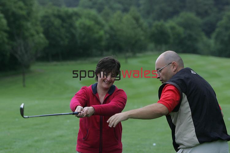 Women & Girls Beginners Golf Class.Coed y Mwstwr Golf Club.20.06.07.©Steve Pope.Sportingwales.The Manor .Coldra Woods.Newport.South Wales.NP18 1HQ.07798 830089.01633 410450.steve@sportingwales.com.www.fotowales.com.www.sportingwales.com