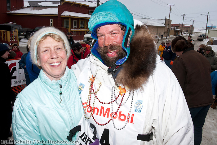 Art Church poses with his wife Bonnie in Nome after finishing in 44th place during the 2010 Iditarod