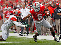 Ohio State Buckeyes wide receiver Evan Spencer (6) tries to get past Florida A&M Rattlers defensive back Patrick Aiken (5) after a catch in the 1st quarter during their college football game at Ohio Stadium on September 21, 2013.  (Dispatch photo by Kyle Robertson)