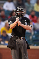 Umpire Adam Beck makes a call during a game between the Jacksonville Suns and Chattanooga Lookouts on April 30, 2015 at AT&T Field in Chattanooga, Tennessee.  Jacksonville defeated Chattanooga 6-4.  (Mike Janes/Four Seam Images)
