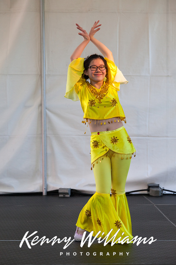 Girls wearing yellow outfits dancing traditional Chinese Dance, Northwest Folklife Festival 2016, Seattle Center, Washington, USA.