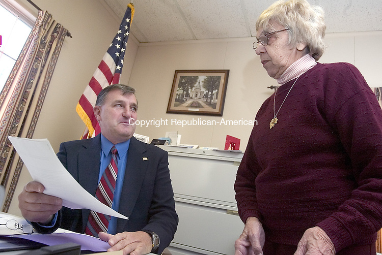 BETHLEHEM, CT. 03 January 2008-010308SV01--First Selectman Jeffrey Hamel goes over some paper work with Town Clerk Lucy Palangio at the town hall in Bethlehem Thursday. Hamel is the first selectman by day and a Waterbury police officer by night.<br /> Steven Valenti Republican-American