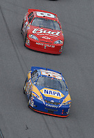 Feb 15, 2007; Daytona, FL, USA; Nascar Nextel Cup Series driver Michael Waltrip (55) leads Dale Earnhardt Jr (8) during race one of the Gatorade Duel at Daytona International Speedway. Mandatory Credit: Mark J. Rebilas