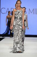 Model walks runway at Carlos Miele show during Miami Fashion Week 2013, Miami Beach, Florida