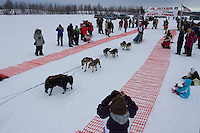 Kevin Harper leaves the start line of the 2014 Jr. Iditarod Sled Dog Race from Happy Trails Kennel, Big Lake, Alaska<br /> Saturday February 22, 2014 <br /> <br /> Junior Iditarod Sled Dog Race 2014<br /> PHOTO BY JEFF SCHULTZ/IDITARODPHOTOS.COM  USE ONLY WITH PERMISSION