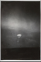 BNPS.co.uk (01202 558833)<br /> Pic: Bonhams/BNPS<br /> <br /> ***Please use full byline***<br /> <br /> A never-seen-before photograph of the infamous first atomic bomb dropped on Hiroshima in the final days of World War II has emerged for sale for &pound;30,000.<br /> <br /> The black and white snap was taken from the navigators window of the US airforce Superfortress carrying scientists and journalists to witness the arrival of the atomic age.<br /> <br /> It shows the enormous mushroom cloud rising above the city moments after bomber plane Enola Gay dropped its catastrophic payload on August 6, 1945.<br /> <br /> The poignant photo was taken by Second Lieutenant Russell Gackenbach, navigator onboard Necessary Evil, one of the three B-29 planes that took part in the attack.<br /> <br /> The grainy image of the explosion has never before been published, remaining in 2nd Lt. Gackenback's  posession until the 1990s when he sold it to a private collector.<br /> <br /> A 3-inch by 2-inch contact print of the photo is now up for sale at Bonhams alongside the Agfa Viking camera 2nd Lt. Gackenback used to take the photograph.