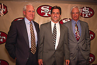 SANTA CLARA, CA - New head coach Steve Mariucci of the San Francisco 49ers is introduced to the media with former head coach George Seifert (right) and former head coach Bill Walsh (left) at the 49ers facility in Santa Clara, California in 1997. Photo by Brad Mangin
