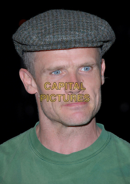 FLEA - RED HOT CHILI PEPPERS.16th Annual Environmental Media Association Awards Gala held at the Wilshire Ebell Theatre,Los Angeles, California, USA..November 8th, 2006.Ref: ADM/CH.headshot portrait Chilli grey gray flat cap hat biting top lip.www.capitalpictures.com.sales@capitalpictures.com.©AdMedia/Capital Pictures. *** Local Caption *** ..