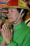 Donggang, Taiwan -- Taoist worshiper praying at the Donglong Temple on the night of the boat burning.