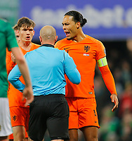 16th November 2019; Windsor Park, Belfast, Antrim County, Northern Ireland; European Championships 2020 Qualifier, Northern Ireland versus Netherlands; Virgil van Dijk (c) of Netherlands reacts to Referee Szymon Marciniak showing a yellow card - Editorial Use