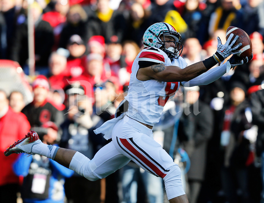 Ohio State Buckeyes wide receiver Devin Smith (9) catches a touchdown pass in the first quarter of the college football game between the Ohio State Buckeyes and the Michigan Wolverines at Michigan Stadium Ann Arbor, Michigan, Saturday afternoon, November 30, 2013. As of half time the Ohio State Buckeyes were tied with the Michigan Wolverines 21 - 21. (The Columbus Dispatch / Eamon Queeney)