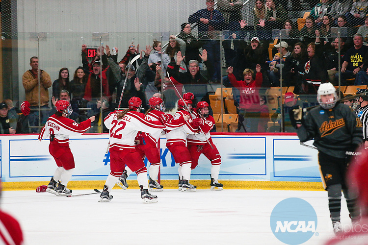 ADRIAN, MI - MARCH 18: Plattsburgh State defender Erin Brand (28) celebrates with teammates after she scores the game winning, overtime goal in the Division III Women's Ice Hockey Championship held at Arrington Ice Arena on March 19, 2017 in Adrian, Michigan. Plattsburgh State defeated Adrian 4-3 in overtime to repeat as national champions for the fourth consecutive year. by Tony Ding/NCAA Photos via Getty Images)