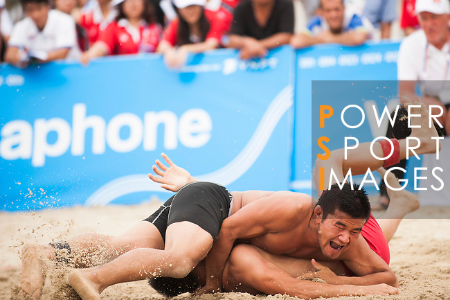 Wrestlers compete during the Beach Wrestling Men's competition between Kyrgyzstan and Mongolia on Day Eight of the 5th Asian Beach Games 2016 at Bien Dong Park on 01 October 2016, in Danang, Vietnam. Photo by Marcio Machado / Power Sport Images