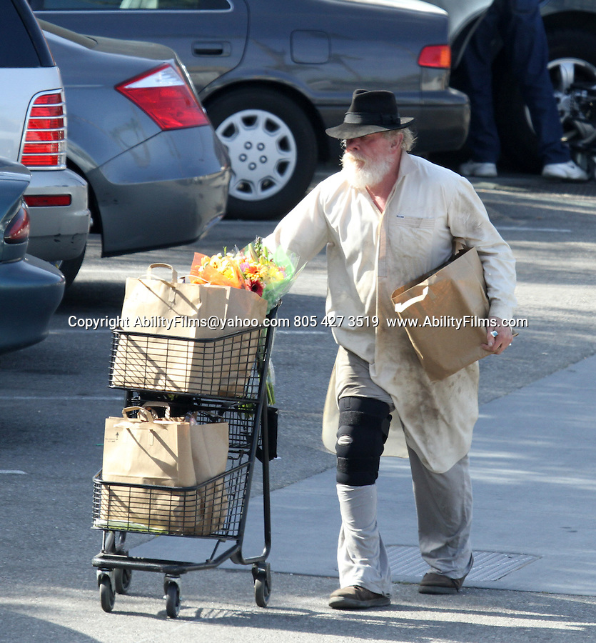 March 23rd 2013    Exclusive <br /> <br /> <br /> Nick Nolte shopping in Malibu California. Nick bought some flowers &amp; food while inside. He was acting very goofy while shopping. <br /> Nick even gave his empty shopping cart a big ghost ride towards the market when he was done with it.  It almost hit three guys sitting down eating lunch. But they were laughing about it. <br /> Nick was also laughing and seemed to be having a good time. Mr. Nolte was wearing a knee brace &amp; a very dirty white trench lab coat jacket rocking a huge beard. At first glance he looked like a  homeless. Mr. Bum Nolte Rules! <br /> <br /> AbilityFilms@yahoo.com<br /> 805 427 3519 <br /> www.AbilityFilms.com