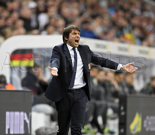 29.03.2016. Munich, Germany. International soccer match between Germany and Italy, at the Allianz Arena in Munich.  Trainer Antonio Conte (Ita) gets animates