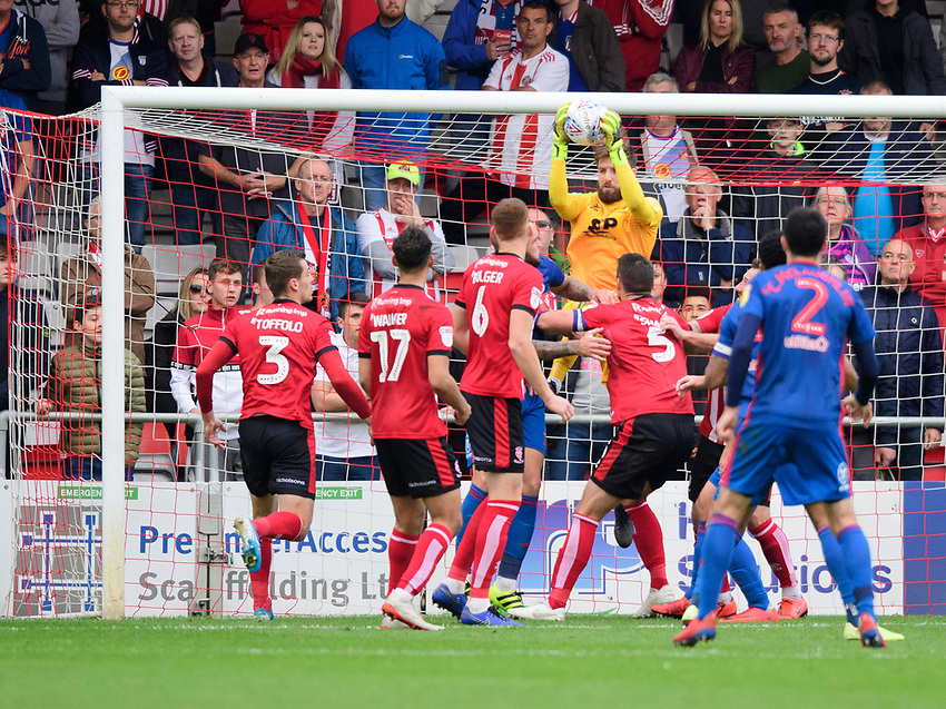 Lincoln City's Josh Vickers makes a save from Sunderland's Jordan Willis<br /> <br /> Photographer Chris Vaughan/CameraSport<br /> <br /> The EFL Sky Bet League One - Lincoln City v Sunderland - Saturday 5th October 2019 - Sincil Bank - Lincoln<br /> <br /> World Copyright © 2019 CameraSport. All rights reserved. 43 Linden Ave. Countesthorpe. Leicester. England. LE8 5PG - Tel: +44 (0) 116 277 4147 - admin@camerasport.com - www.camerasport.com