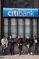 5 men standing outside the citibank in Shanghai, China.