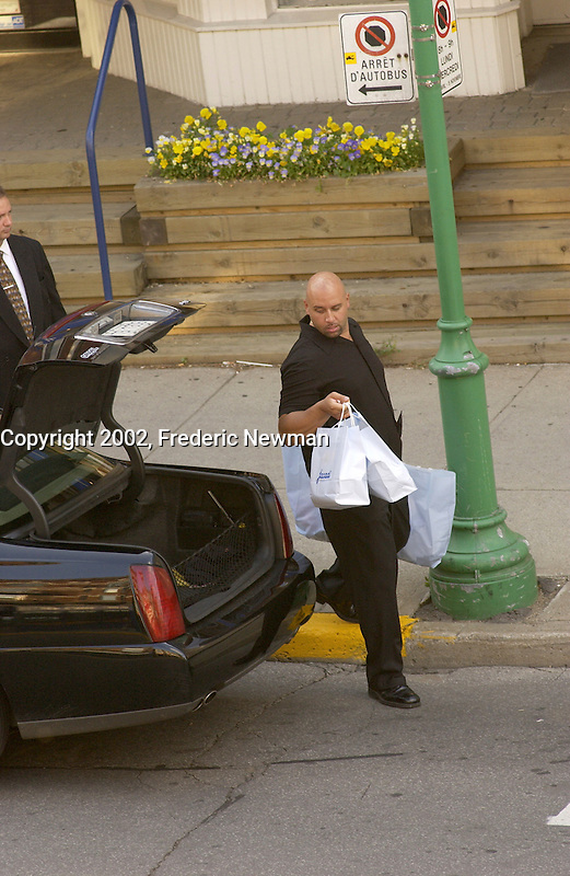 July 27  2002,Montreal, Quebec, Canada; <br /> <br /> EXCLUSIVE PHOTO <br /> One of Celine Dion's bodyguards load bags into the limo,outside of  of Jacadi, kid clothing store, on Laurier street in Montreal, July 27,  2002<br /> <br /> (Mandatory Credit: Photo by Frederic Newman - Images Distribution (&copy;) Copyright 2002 by Frederic Newman<br /> <br /> Worlwide rights (except  Canada) exclusive to Famous UK, Canada Out<br /> <br /> NOTE :  D-1 X original JPEG, saved as Adobe 1998 RGB