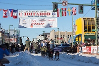 Hans Gatt and team leave the ceremonial start line with an Iditarider and handler at 4th Avenue and D street in downtown Anchorage, Alaska on Saturday March 4th during the 2017 Iditarod race. Photo © 2017 by Brendan Smith/SchultzPhoto.com.