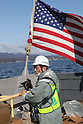 OSHIMA, Japan - Sasaki Masaetsu, city maintenance manager, and the person in charge of restoring electrical service on the isolated island of Oshima, rides a U.S. Navy landing craft carrying Japanese utility repair vehicles. The 31st Marine Expeditionary Unit and Amphibious Squadron 11 picked up the vehicles from the Kessenuma port and delivered food, water, comfort items and the vehicles to assist in restoring power. The island of Oshima has been cut off from the mainland since the earthquake and tsunami March 11. The operation demonstrated the expeditionary capabilities in ship-to-shore amphibious operations. Marines and Sailors of the 31st MEU are conducting humanitarian aid and disaster relief missions in northeast Japan assisting the Japanese Self Defense Forces in their ongoing operations. (Photo by USMC/AFLO) [0006]