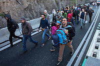 Pictured: Migrants walk on the motorway Thursday 25 February 2016<br />