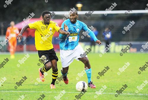2014-09-06 / Voetbal / seizoen 2014-2015 / KV Turnhout - Berchem Sport / Noel Nyason (l. Berchem) met Bruno Kwani<br /><br />Foto: Mpics.be