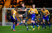 Lincoln City's Mark O'Hara vies for possession with Mansfield Town's Krystian Pearce<br /> <br /> Photographer Chris Vaughan/CameraSport<br /> <br /> The EFL Sky Bet League Two - Mansfield Town v Lincoln City - Monday 18th March 2019 - Field Mill - Mansfield<br /> <br /> World Copyright © 2019 CameraSport. All rights reserved. 43 Linden Ave. Countesthorpe. Leicester. England. LE8 5PG - Tel: +44 (0) 116 277 4147 - admin@camerasport.com - www.camerasport.com