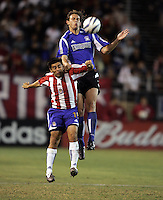 10 September 2005: Kelly Gray of the Earthquakes battles for the ball in the air with Antonio Martinez of the CD Chivas USA during the second half of the game at Spartan Stadium in San Jose, California.    San Jose Earthquakes defeated CD Chivas USA, 3-0.