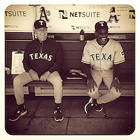 OAKLAND, CA - JUNE 7: Instagram of Texas Rangers coach Jackie Moore and manager Ron Washington sitting in the dugout before the game against the Oakland Athletics at the O.co Coliseum on June 7, 2012 in Oakland, California. (Photo by Brad Mangin)