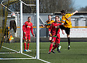 Alloa's Kevin Cawley heads home their first goal.