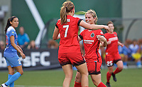 Portland, Oregon - Wednesday June 22, 2016: Portland Thorns FC midfielder Amandine Henry (28) and Lindsey Horan (7) celebrate a goal during a regular season National Women's Soccer League (NWSL) match at Providence Park.