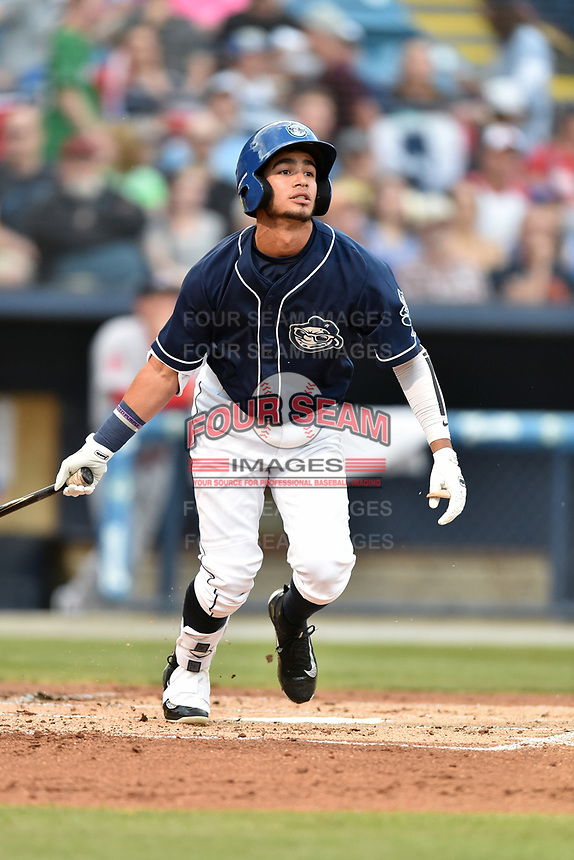 Asheville Tourists center fielder Manny Melendez (19) swings at a pitch during a game against the Greenville Drive at McCormick Field on April 13, 2017 in Asheville, North Carolina. The Tourists defeated the Drive 3-1. (Tony Farlow/Four Seam Images)