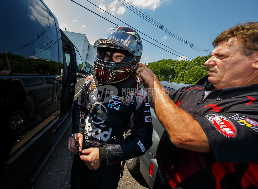 Jun 10, 2017; Englishtown , NJ, USA; NHRA funny car driver Jonnie Lindberg with crew member during qualifying for the Summernationals at Old Bridge Township Raceway Park. Mandatory Credit: Mark J. Rebilas-USA TODAY Sports