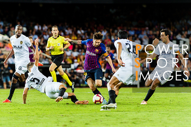 Gabriel Armando de Abreu of Valencia CF (L) trips up with Lionel Messi of FC Barcelona (C) during their La Liga 2018-19 match between Valencia CF and FC Barcelona at Estadio de Mestalla on October 07 2018 in Valencia, Spain. Photo by Maria Jose Segovia Carmona / Power Sport Images