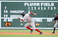 Outfielder Felix Sanchez (34) of the Greenville Drive takes off for third base in a game against the Charleston RiverDogs on July 31, 2011, at Fluor Field at the West End. Sanchez is wearing a throwback jersey honoring the Upstate's textile mill baseball teams on a night when the Drive celebrated Mill League Night. The throwback jerseys were auctioned off after the game. (Tom Priddy/Four Seam Images)