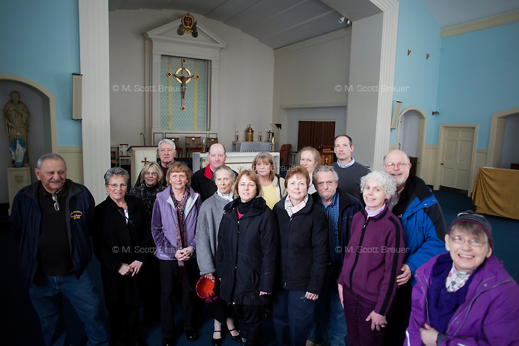 Family members of residents and resident Marilyn Davidson (right) pose in the Chapel of the Holy Innocents in Waltham, Massachusetts, USA.