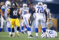 James Harrison #92 of the Pittsburgh Steelers looks on as Matt Hasselbeck #8 of the Indianapolis Colts lays on the ground after being sacked in the second half during the game at Heinz Field on December 6, 2015 in Pittsburgh, Pennsylvania. (Photo by Jared Wickerham/DKPittsburghSports)