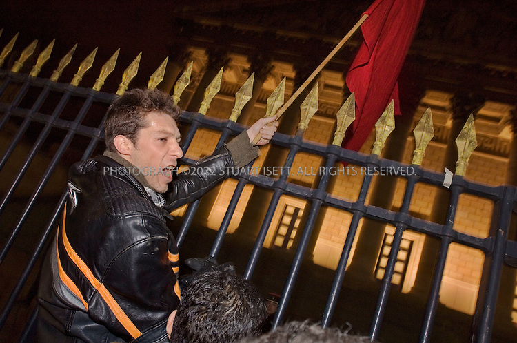 3/31/2006--Paris, France..Demonstators attempt to climb the gates of the National Assembly after a national address by French President Jacques Chirac from the Elysee Palace in Paris March 31, 2006, to explain how he aims to end weeks of strikes and huge demonstrations against the CPE First Job Contract, which critics say undermines job security for young workers. Thousands of students took to the streets of Paris and marched all evening in protest after the speech...Photograph By Stuart Isett.All photographs ©2006 Stuart Isett.All rights reserved.