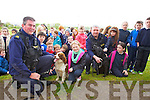 Gardai with the sniffer dog unit Patrick Harrington and John Hodnett with pupils from Blennerville NS  Michaela Brosnan McAdams and Siobhan O'Sullivan during a demonstration of the Dog unit to children from Blennerville NS and Caherlaheen NS at St. Pats Gaa Pitch on Wednesday.