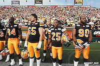 September 7, 2009; Hamilton, ON, CAN; Hamilton Tiger-Cats defensive lineman Khari Long (94) offensive lineman Simeon Rottier (65) linebacker Markeith Knowlton (25) defensive lineman Demonte' Bolden (90). CFL football - the Labour Day Classic - Toronto Argonauts vs. Hamilton Tiger-Cats at Ivor Wynne Stadium. The Tiger-Cats defeated the Argos 34-15. Mandatory Credit: Ron Scheffler.