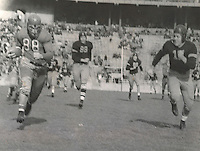 Black and white file photo.  Sarringhaus (#88, OSU) around right end for 45 yard gain.  OSU-Iowa Pre-Flight game, first quarter. Game was played November 28, 1942.  Iowa Pre-Flight Seahawks - NOT Iowa Hawkeyes.Ohio State; football action; Seahawks; Buckeyes. (Dispatch file photo)
